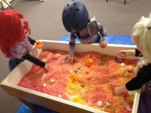 Little Ariel, Bode Miller ca. 1985, and Elsa search in the rice table for treasures.
